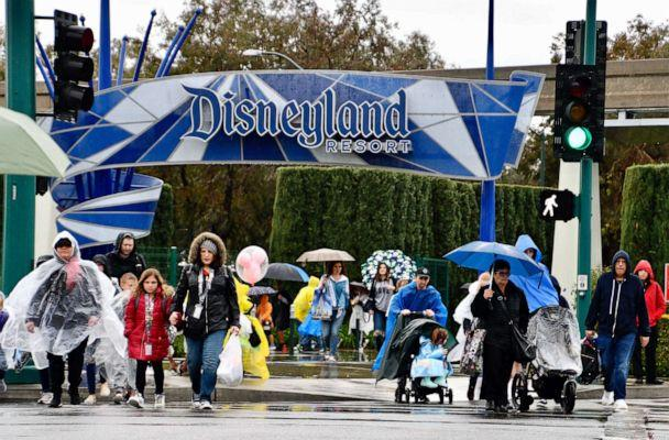 PHOTO: Visitors cross Harbor Blvd. as they leave Disneyland in Anaheim, Calif., March 12, 2020. (Jeff Gritchen/Orange County Register/SCNG via Zuma Press via Newscom)