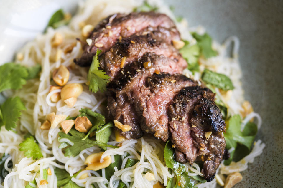 This image released by Milk Street shows a recipe for ginger beef and rice noodle salad. (Milk Street via AP)