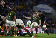 South Africa's Faf de Klerk, second left, clears the ball from the ruck during their Rugby Championship test match against New Zealand on the Gold Coast, Australia, Saturday, Oct. 2, 2021. (AP Photo/Tertius Pickard)
