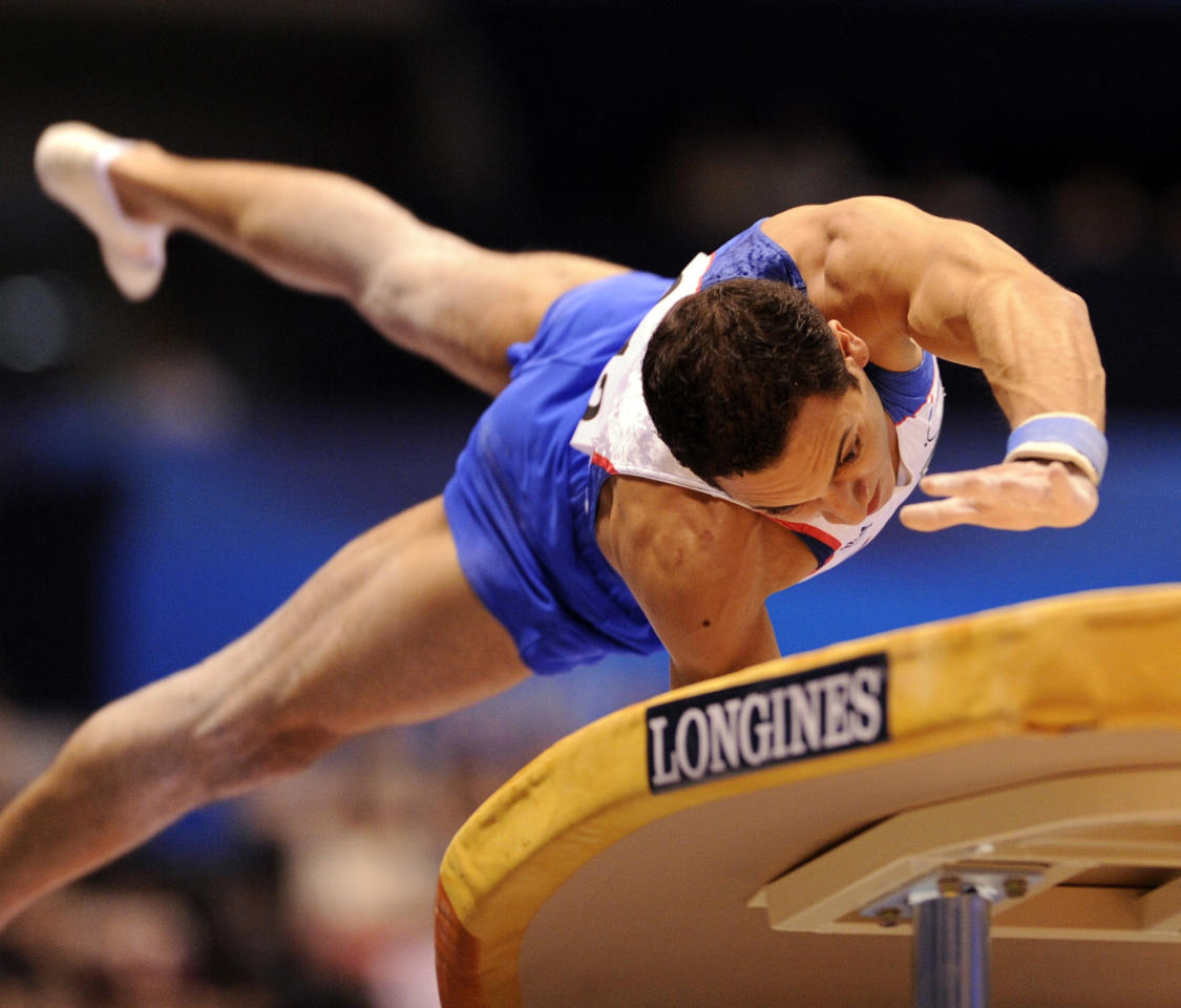 Thomas Bouhail of France performs on the vault during men's vault final of the World Gymnastics Championships in Tokyo on October 16, 2011.   AFP PHOTO / KAZUHIRO NOGI (Photo credit should read KAZUHIRO NOGI/AFP/Getty Images)