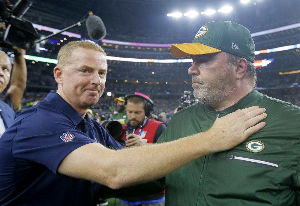 FILE - In this Jan. 15, 2017, file photo, Dallas Cowboys coach Jason Garrett, left, congratulates Green Bay Packers coach Mike McCarthy after their 34-31 win in an NFL divisional playoff football game in Arlington, Texas. For decades, dating back to Lombardi and Landry, the Packers against the Cowboys has been one of the NFL's juiciest rivalries. It got some extra spice in the playoffs last January. On Sunday, they meet again.  (AP Photo/Tony Gutierrez, File)