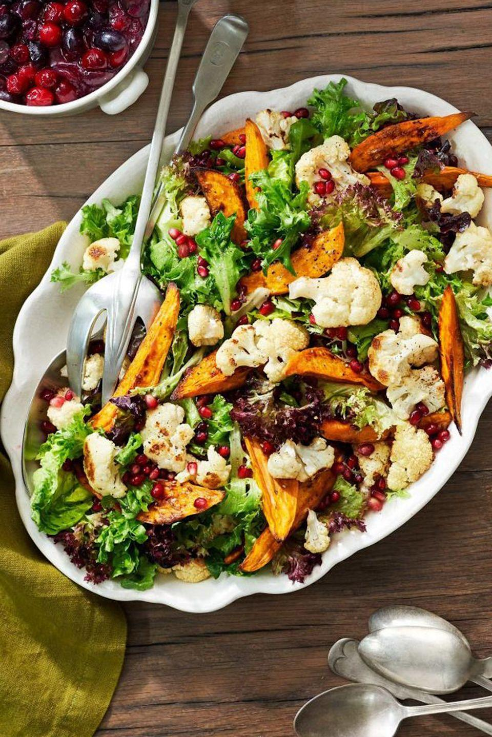 """<p>Find pomegranate seeds in stores from October through January. If you can't find 'em, sub in dried cranberries for a similar boost of tart sweetness. </p><p><a href=""""https://www.countryliving.com/food-drinks/recipes/a40029/sweet-potato-and-cauliflower-salad-recipe/"""" rel=""""nofollow noopener"""" target=""""_blank"""" data-ylk=""""slk:Get the recipe from Country Living »"""" class=""""link rapid-noclick-resp""""><em>Get the recipe from Country Living »</em> </a></p>"""