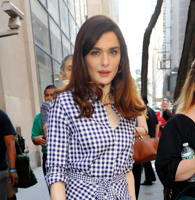 <p>Weisz was a vision of summer after an appearance on the <em>Today</em> show in a blue and white gingham dress and voluminous hair. (Photo by Jackson Lee/GC Images) </p>
