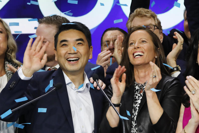 Zoom CEO Eric Yuan, left, and Adena Friedman, President and CEO of Nasdaq, attend the opening bell at Nasdaq as his company holds its IPO, Thursday, April 18, 2019, in New York. (AP Photo/Mark Lennihan)