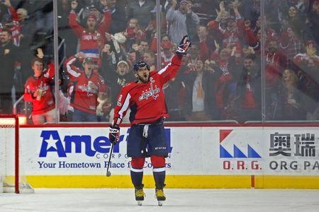 Dec 16, 2017; Washington, DC, USA; Washington Capitals left wing Alex Ovechkin (8) celebrates after scoring the game-winning goal in overtime against the Anaheim Ducks at Capital One Arena. The Capitals won 3-2 in overtime. Mandatory Credit: Geoff Burke-USA TODAY Sports