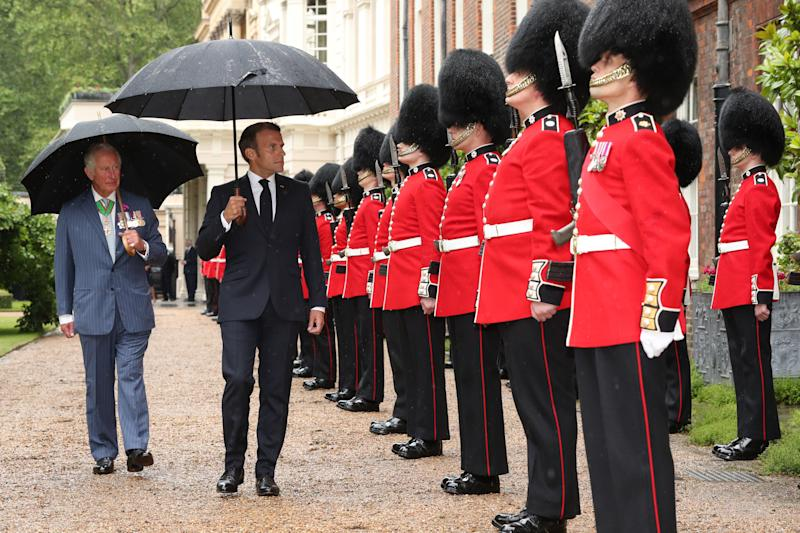 Britain's Prince Charles, Prince of Wales (R) and French President Emmanuel Macron (L) inspect a guard of honour from the Grenadier Guards at Clarence House in central London on June 18, 2020 as he arrives for a visit to mark the anniversary of former French president Charles de Gaulle's appeal to French people to resist the Nazi occupation. - Macron visited London on June 18 to commemorate the 80th anniversary of former French president Charles de Gaulle's appeal to French people to resist the Nazi occupation during World War II. (Photo by Jonathan Brady / POOL / AFP) (Photo by JONATHAN BRADY/POOL/AFP via Getty Images)