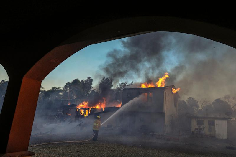 A structure burns on Dec. 5 in Los Angeles' Shadow Hills neighborhood.