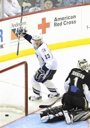 Tampa Bay Lightning's Pavel Kubina (13) celebrates his goal against the Pittsburgh Penguins' goalie Brent Johnson (1) during the third period of Game 5 of their NHL Eastern Conference quarter-final hockey game in Pittsburgh, Pennsylvania, April 23, 2011. REUTERS/David DeNoma