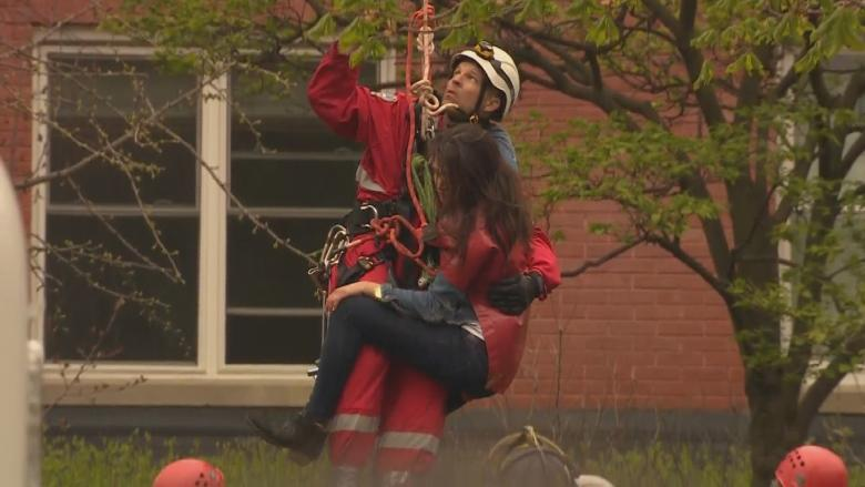 Meet the firefighter who rescued a woman stuck on a crane in downtown Toronto