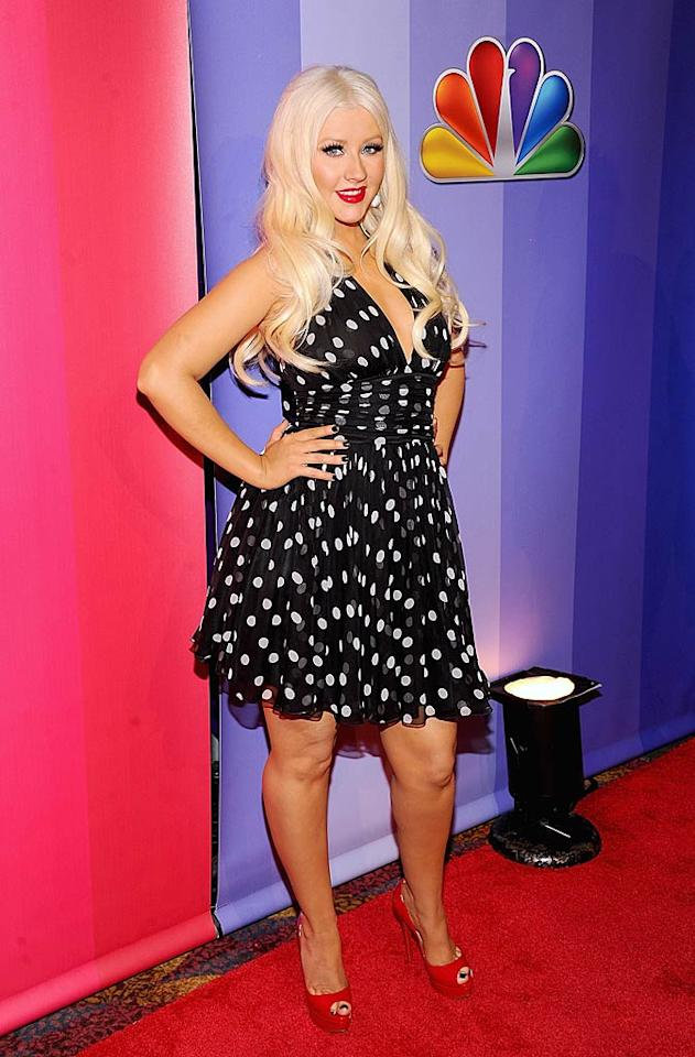 """Christina Aguilera posed in polka dots at the 2011 NBC Upfronts on Monday. Upfront week gives networks a chance to introduce their fall primetime lineup to advertisers, and Xtina was there representing the new NBC reality competition show """"The Voice."""" Jamie McCarthy/<a href=""""http://www.wireimage.com"""" target=""""new"""">WireImage.com</a> - May 16, 2011"""