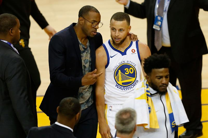 OAKLAND, CA - MAY 31: Stephen Curry #30 of the Golden State Warriors talks with Andre Iguodala #9 during a timeout against the Cleveland Cavaliers in Game 1 of the 2018 NBA Finals at ORACLE Arena on May 31, 2018 in Oakland, California. NOTE TO USER: User expressly acknowledges and agrees that, by downloading and or using this photograph, User is consenting to the terms and conditions of the Getty Images License Agreement. (Photo by Lachlan Cunningham/Getty Images)
