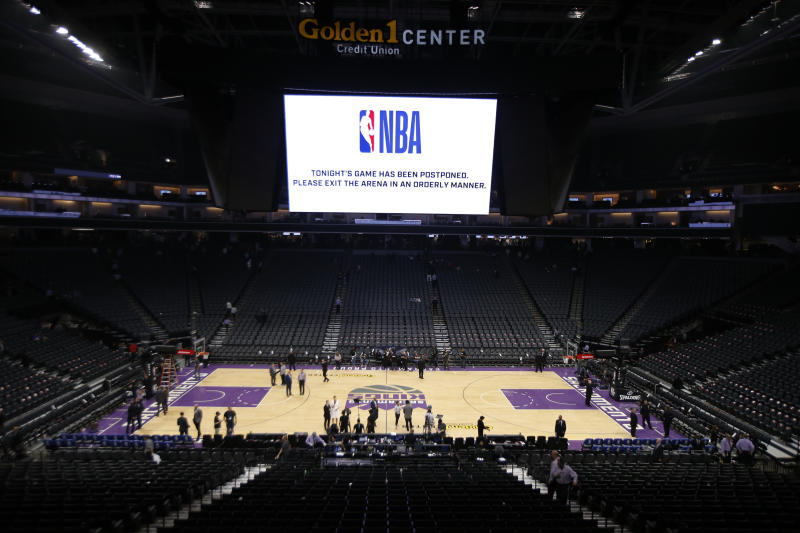 "The Golden 1 Center center empties out after the NBA basketball game between the New Orleans Pelicans and Sacramento Kings was postponed at the last minute in Sacramento, Calif., Wednesday, March 11, 2020. The postponement was due to what the league said was an ""abundance of caution,"" because official Courtney Kirkland, who was scheduled to work the game, had worked the Utah Jazz game earlier in the week. A player for the Jazz tested positive for the coronavirus. (AP Photo/Rich Pedroncelli)"
