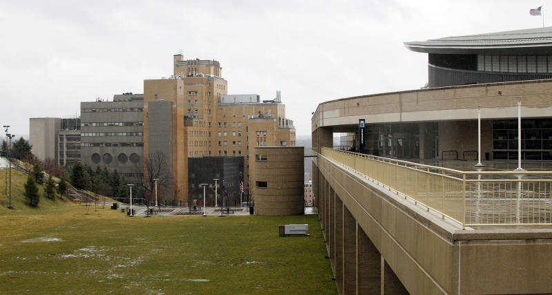 The Western Psychiatric Institute and Clinic on the University of Pittsburgh is seen at left near the Petersen Events Center at right on campus, Thursday, March 8, 2012 in Pittsburgh. There were reports of gunfire at the psychiatric clinic injuring several people, and police were looking for a gunman. (AP Photo/Keith Srakocic)