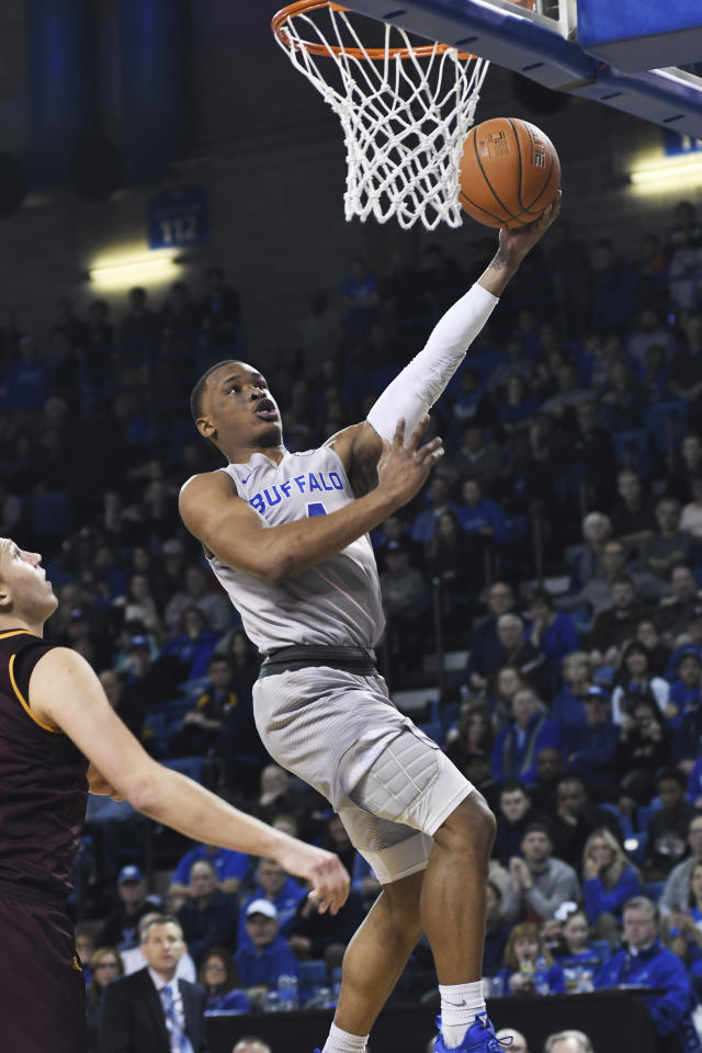 Buffalo's Davonta Jordan, center, goes for a layup against Central Michigan during an NCAA college basketball game in Buffalo, N.Y., Saturday, Feb. 9, 2019. (AP Photo/Heather Ainsworth)