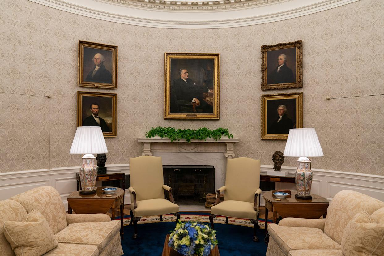 Portraits of former Presidents Franklin D. Roosevelt, Abraham Lincoln, George Washington and Thomas Jefferson, and Treasury Secretary Alexander Hamilton are seen in President Joe Biden's Oval Office. (Photo: ASSOCIATED PRESS)