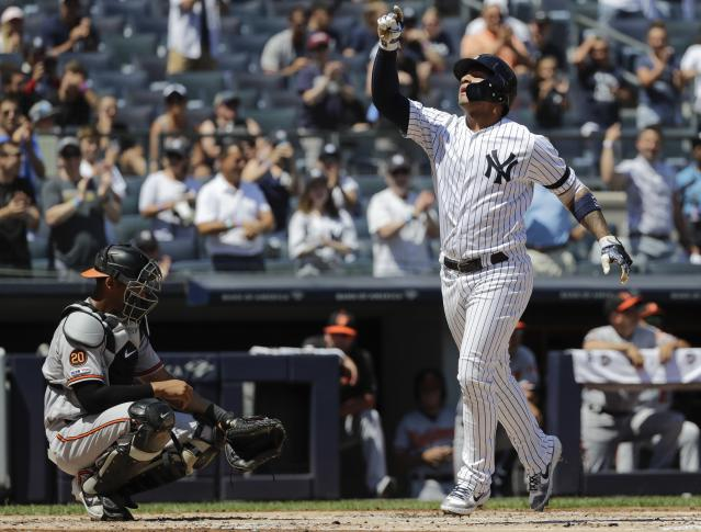 New York Yankees' Gleyber Torres, right, celebrates as he reaches home plate after hitting a home run as Baltimore Orioles catcher Pedro Severino, left, reacts during the first inning of the first game of a baseball doubleheader Monday, Aug. 12, 2019, in New York. (AP Photo/Frank Franklin II)