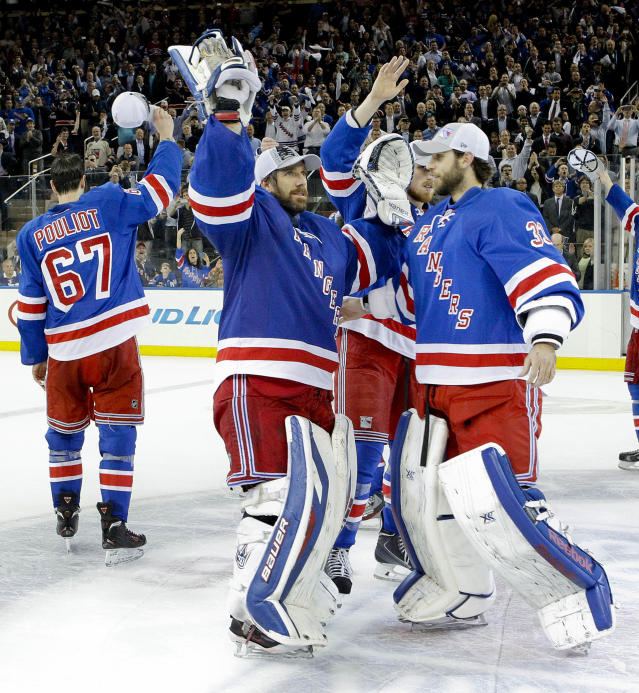New York Rangers goalie Henrik Lundqvist (30) and goalie Cam Talbot (33) wave to fans after beating the Montreal Canadiens 1-0 in Game 6 of the NHL hockey Stanley Cup playoffs Eastern Conference finals, Thursday, May 29, 2014, in New York