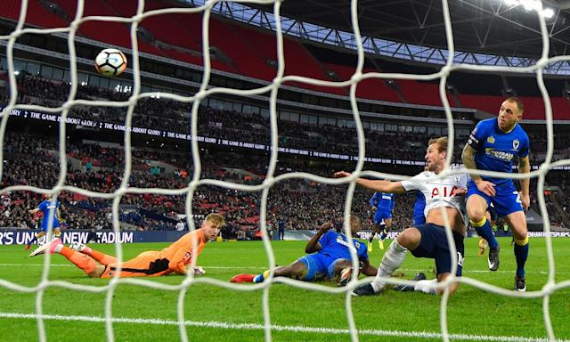 Harry Kane scores Tottenham's first goal in their 3-0 FA Cup win against AFC Wimbledon at Wembley on Sunday.