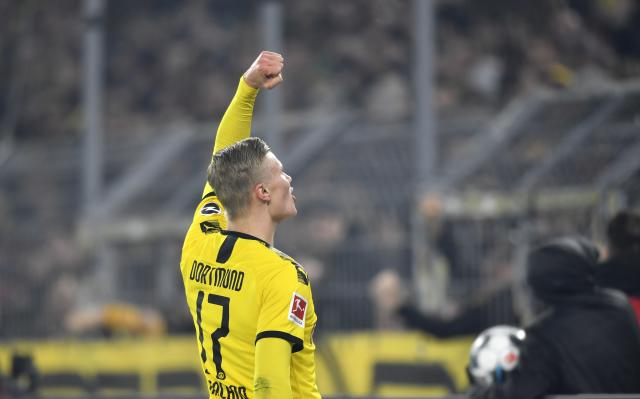 Dortmund's Erling Braut Haaland celebrates after scoring his side's third goal during the German Bundesliga soccer match between Borussia Dortmund and Eintracht Frankfurt in Dortmund, Germany, Friday, Feb. 14, 2020. (AP Photo/Martin Meissner)