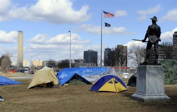 A statue honoring soldiers from the Spanish American War stands guard over an Occupy Wall Street encampment as the Liberty Memorial Tower soars above the National World War One Museum in Kansas City Missouri February 24, 2012.