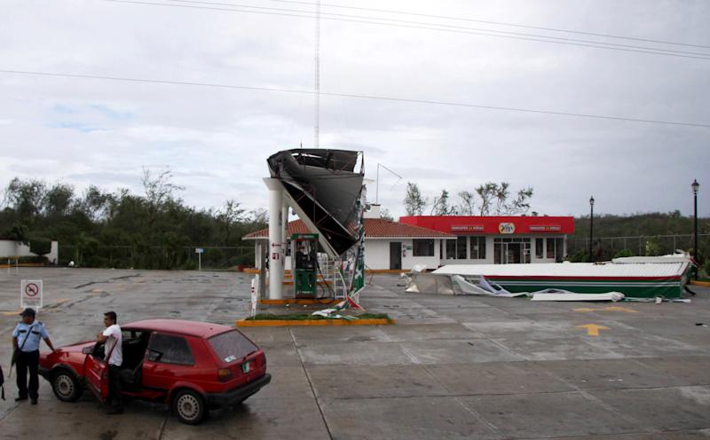A fuel station's roof sits on the ground after being ripped off by Hurricane Carlotta along the Pacific coast in Puerto Escondido, Mexico, Saturday June 16, 2012. Carlotta arrived in Puerto Escondido as a Category 1 hurricane. Carlotta was downgraded to a tropical depression on Saturday as the system rapidly weakened after killing two young sisters in its march across southern Mexico. (AP Photo)