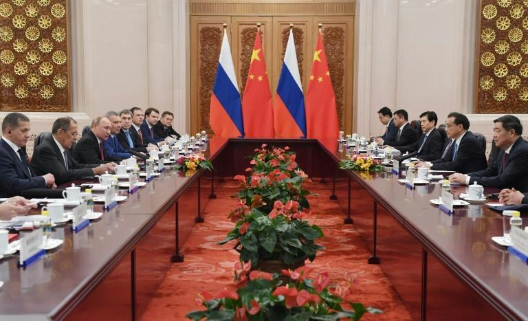 Russian President Vladimir Putin held talks with China's Premier Li Keqiang in the Great Hall of the People