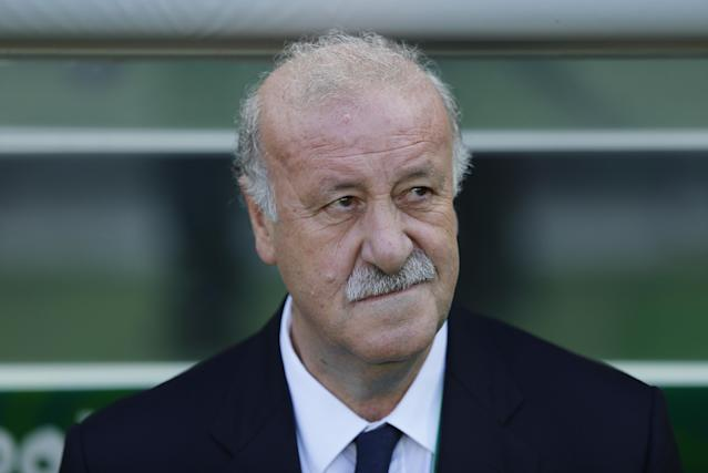 FILE - This June 27, 2013, file photo, Spain's head coach Vicente Del Bosque listen to the national anthems prior to a soccer Confederations Cup semifinal match against Italy at the Castelao stadium in Fortaleza, Brazil. Del Bosque is expected to lead Spain in a performance equal to the one in the previous world cup. (AP Photo/Victor R. Caivano, File)