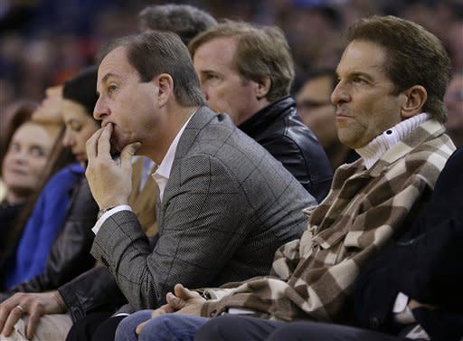 Golden State Warriors co-owners Joe Lacob, left, and Peter Guber watch during the final seconds of an NBA basketball game against the Houston Rockets Friday, March 8, 2013, in Oakland, Calif. (AP Photo/Ben Margot)