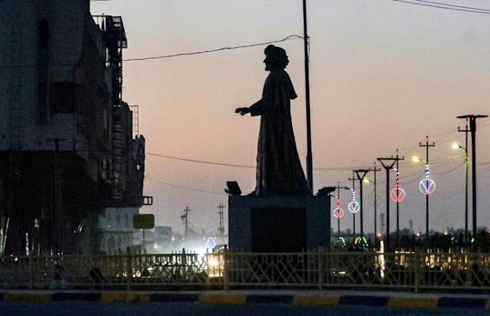 A statue of a local poet is one of a half-dozen works by local artists erected across the northern Iraqi city since the Islamic State group lost control of it three years ago