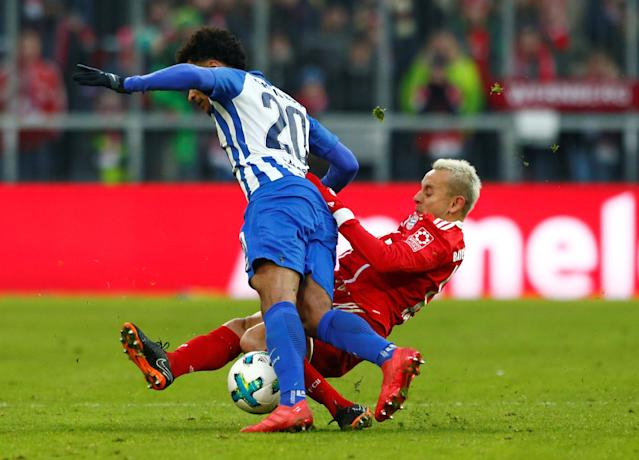 Soccer Football - Bundesliga - Bayern Munich vs Hertha BSC - Allianz Arena, Munich, Germany - February 24, 2018 Bayern Munich's Rafinha in action with Hertha Berlin's Valentino Lazaro REUTERS/Michaela Rehle DFL RULES TO LIMIT THE ONLINE USAGE DURING MATCH TIME TO 15 PICTURES PER GAME. IMAGE SEQUENCES TO SIMULATE VIDEO IS NOT ALLOWED AT ANY TIME. FOR FURTHER QUERIES PLEASE CONTACT DFL DIRECTLY AT + 49 69 650050
