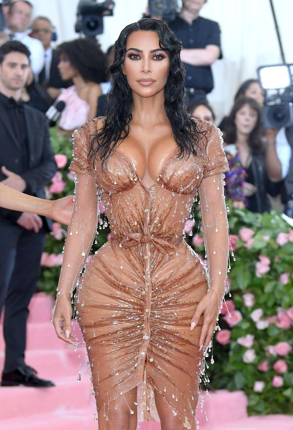 """<p>Kim Kardashian turned heads at the Met Gala again in 2019 while wearing this sheer beaded dress made by Thierry Mugler. This dress was considered controversial because in addition to being very sheer, people just could <em>not</em> believe Kim's waist was really that small. Turns out, the <a href=""""https://www.wmagazine.com/story/kim-kardashian-met-gala-corset-mugler-mr-pearl/"""" rel=""""nofollow noopener"""" target=""""_blank"""" data-ylk=""""slk:secret was a tight, custom-made corset and a rigorous exercise schedule"""" class=""""link rapid-noclick-resp"""">secret was a tight, custom-made corset and a rigorous exercise schedule</a>. </p>"""