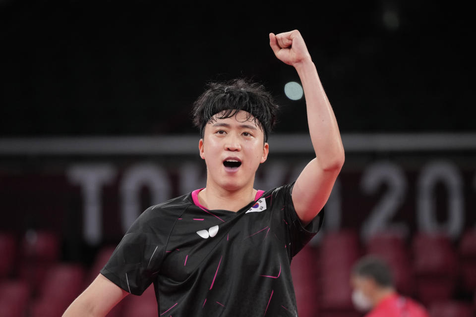 South Korea's Jeoung Youngsik reacts during the table tennis men's singles third round match against Greece's Panagiotis Gionis at the 2020 Summer Olympics, Tuesday, July 27, 2021, in Tokyo. (AP Photo/Kin Cheung)