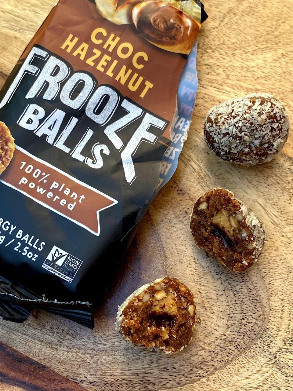 <p>When I bit into one of these Choc Hazenut Frooze Balls, there was a surprise - a creamy hazelnut butter and a fudgy center! It tasted delicious paired with the shredded coconut, and was almost dessert-like. The texture was soft and chewy, and the surprise center made them more special than an ordinary energy ball or bar.</p>