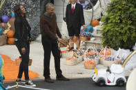 <p>While the kids went all out — there was a baby dressed as a Pope in his own makeshift Popemobile, lots of princesses, and even some presidents — the Obamas took the opportunity to step outside in their casual clothes. The first lady dressed like any other soccer mom in black jeans, a tie dye T-shirt, moto jacket, and Converse sneakers. </p>