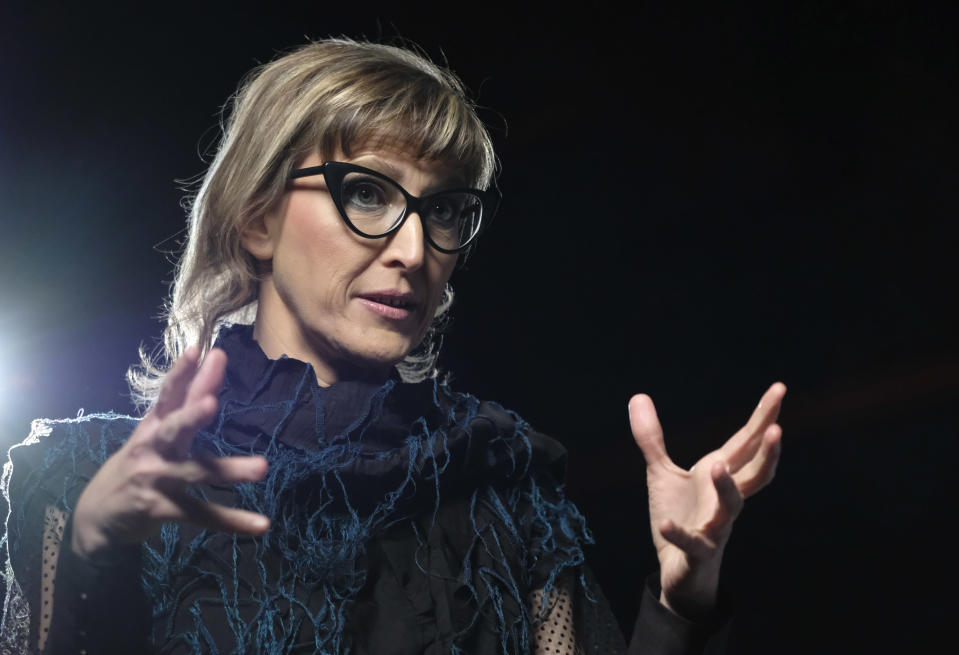 "Bosnian filmmaker Jasmila Zbanic speaks and gestures during an interview with the Associated Press in the capital Sarajevo, Bosnia, Saturday, Jan. 30, 2021. Zbanic's latest and the most ambitious film ""Quo Vadis, Aida?"", based on true events from Bosnia's brutal 1992-95 inter-ethnic war has been many years in the making. (AP Photo/Kemal Softic)"