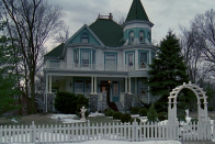 """<p>In real life, like in the movie, the victorian is actually a bed and breakfast, and you can <a href=""""https://www.tripadvisor.com/Hotel_Review-g36910-d12949096-Reviews-The_Cherry_Tree_Inn_Bed_and_Breakfast-Woodstock_Illinois.html"""" rel=""""nofollow noopener"""" target=""""_blank"""" data-ylk=""""slk:stay there"""" class=""""link rapid-noclick-resp"""">stay there</a> still! The <a href=""""https://cherrytreeinnbnb.com/"""" rel=""""nofollow noopener"""" target=""""_blank"""" data-ylk=""""slk:Cherry Tree Inn"""" class=""""link rapid-noclick-resp"""">Cherry Tree Inn</a> bed and breakfast sits in Woodstock, Illinois not Punxsutawney, Pennsylvania. The spectacular house is worth a stay if you find yourself in that suburb of Chicago. <br> <br>344 Fremont StWoodstock, IL 60098</p>"""