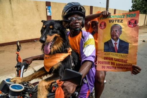 Canine backing: Supporters of opposition candidate Jean-Pierre Fabre, champion of the National Alliance for Change party