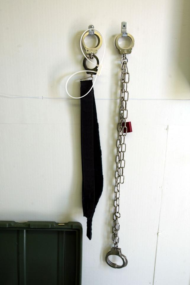 GUANTANAMO BAY, CUBA - APRIL 7:  Restraining devices hang from the wall of a prisoner's cell at Camp Echo April 7, 2004 where detainees from the U.S. war in Afghanistan will meet their lawyers before going to a U.S. military tribunal in Guantanamo Bay, Cuba. On April 20, the U.S. Supreme Court is expected to consider whether the detainees can ask U.S. courts to review their cases. Approximately 600 prisoners from the U.S. war in Afghanistan remain in detention.  (Photo by Joe Raedle/Getty Images)