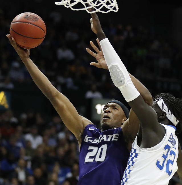 Kansas State forward Xavier Sneed (20) shoots against Kentucky forward Wenyen Gabriel (32) during the first half of a regional semifinal NCAA college basketball tournament game, Thursday, March 22, 2018, in Atlanta. (AP Photo/David Goldman)