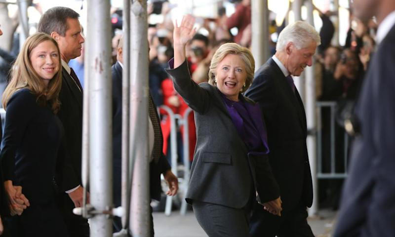 Hillary Clinton waves to a crowd as she arrives to speak to her staff and supporters after losing the race for the White House.