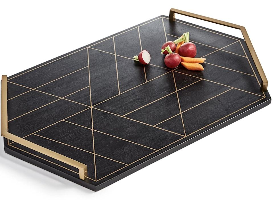<p>Serve your cheese spreads in style with this glamorous <span>Hotel Collection Black &amp; Gold Inlay Tray</span> ($50, originally $144). It's a sophisticated board that is made with stainless steel handles and mango wood.</p>