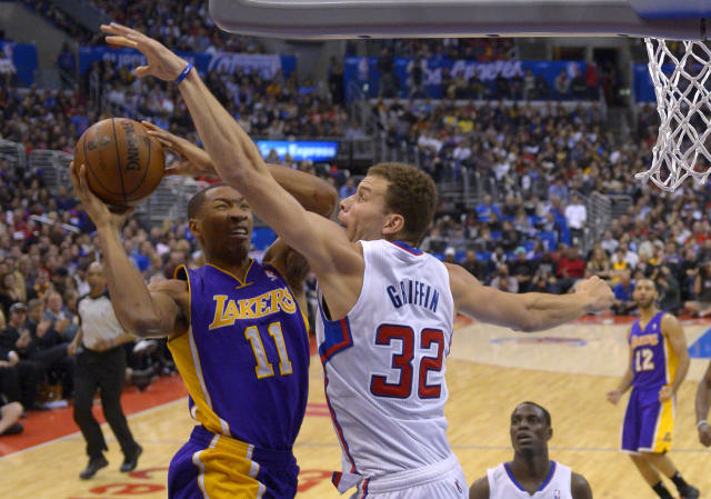 Los Angeles Lakers guard Wesley Johnson, left, puts up a shot as Los Angeles Clippers forward Blake Griffin defends during the first half of an NBA basketball game, Friday, Jan. 10, 2014, in Los Angeles. (AP Photo/Mark J. Terrill)