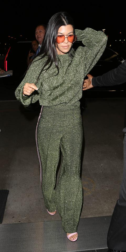 <p>The eldest Kardashian sister hit headlines this week after sporting a sparkly green H&M tracksuit to the airport.<br /><i>[Photo: Getty]</i> </p>