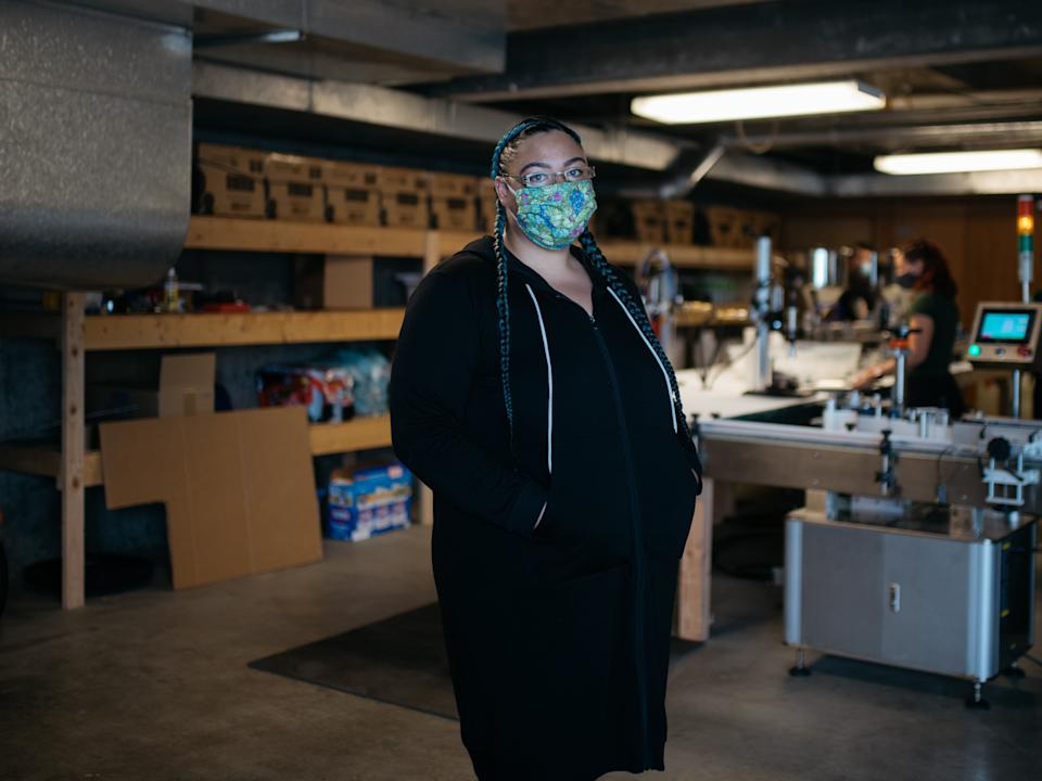 Sherae Lascelles, founder of Seattle's Green Light Project, a nonprofit that gives sanitation products and cash to sex workers, got the idea of making hand sanitizer after supplies began to run out in early March. (Photo: Grant Hindsley for HuffPost)