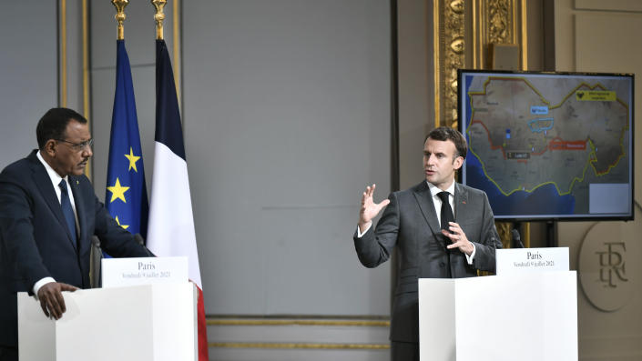 French President Emmanuel Macron, right, and Niger's President Mohamed Bazoum hold a press conference after a video summit with leaders of G5 Sahel countries at the Elysee presidential Palace in Paris, Friday July 9, 2021. French President Emmanuel Macron said Friday his country will withdraw more than 2,000 troops from an anti-extremism force in Africa's Sahel region starting in the coming months. Macron announced last month a future reduction of France's military presence, arguing that the current operation is no longer adapted to the need. (Stephane de Sakutin, Pool photo via AP)