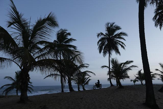 A Brazilian police patrols the coast where the 2014 World Cup draw will take place in Costa do Sauipe, Brazil, Wednesday, Dec. 4, 2013. World Cup organizers say they have spent $11 million to organize the 90-minute show that will be beamed around the world on Friday. (AP Photo/Silvia Izquierdo)