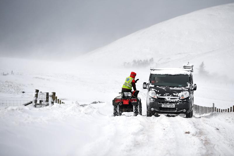 Vehicles struggle through snow on the B797 between Leadhills and Wanlockheadon (Getty Images)