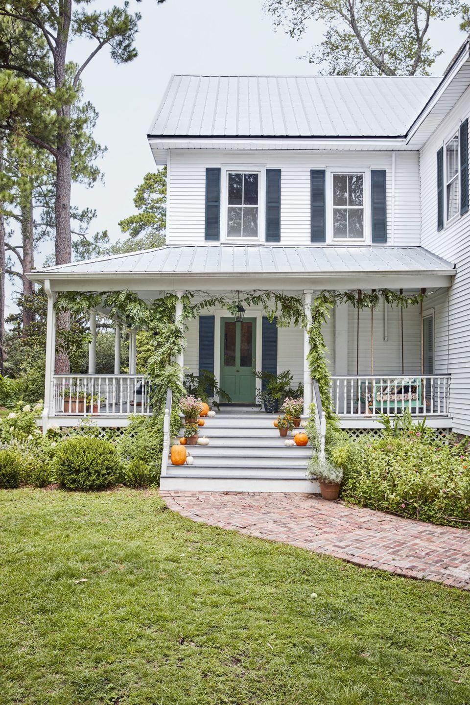 """<p>A soothing shade of green will look gorgeous on your front porch throughout each season.</p><p><a class=""""link rapid-noclick-resp"""" href=""""https://go.redirectingat.com?id=74968X1596630&url=https%3A%2F%2Fwww.farrow-ball.com%2Fen-us%2Fpaint-colours%2Farsenic&sref=https%3A%2F%2Fwww.countryliving.com%2Fhome-design%2Fcolor%2Fg31158913%2Ffront-door-colors%2F"""" rel=""""nofollow noopener"""" target=""""_blank"""" data-ylk=""""slk:SHOP ARSENIC GREEN BY FARROW AND BALL"""">SHOP ARSENIC GREEN BY FARROW AND BALL</a></p>"""