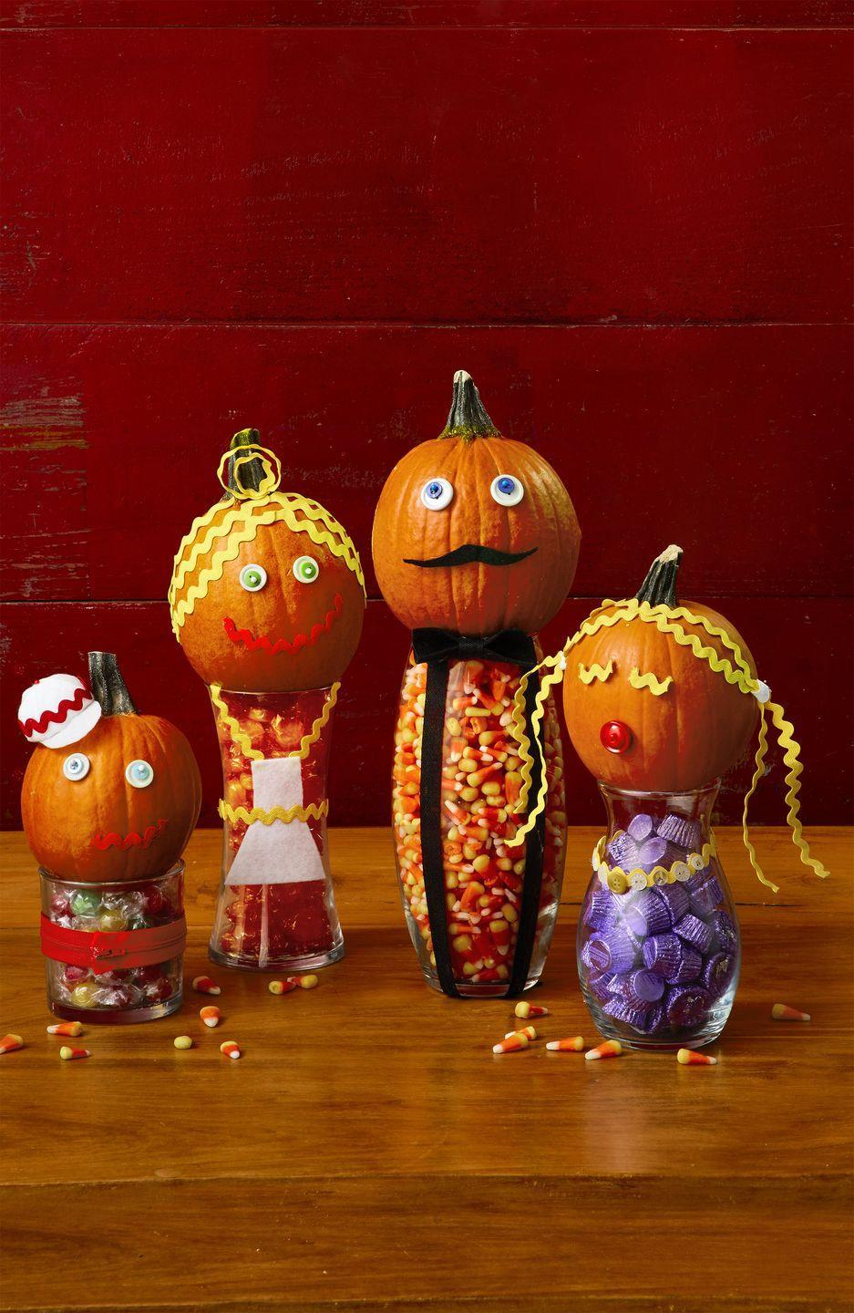 """<p>Fill clear jars with candy. Decorate small to medium pumpkins with rickrack, googly eyes, buttons, felt, and zippers to create features and wardrobe. Use pins and hot glue to attach. For baseball cap, cut a 1 1/2"""" Styrofoam ball in half. Cut four to five white felt triangles to form dome and a semicircle for brim. Attach with glue and add rickrack for embellishment.</p>"""
