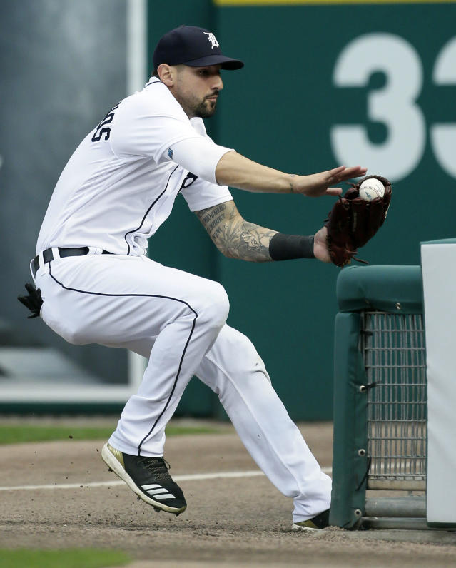 Detroit Tigers right fielder Nicholas Castellanos tries to avoid the fence in foul territory after catching a foul ball for the out on Cleveland Indians' Brandon Guyer during the sixth inning of a baseball game Saturday, July 28, 2018, in Detroit. (AP Photo/Duane Burleson)